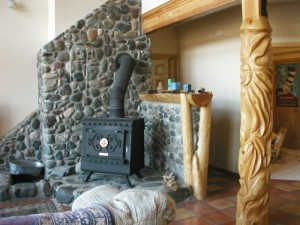 carved post 'Salmon Goddess' and hand picked local river rock