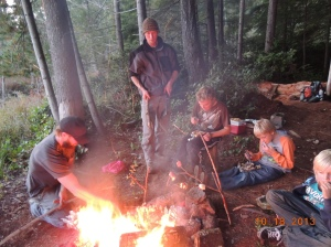 How to cook dinner around the fire.   Foil dinners, kabobs on a stick and smores!